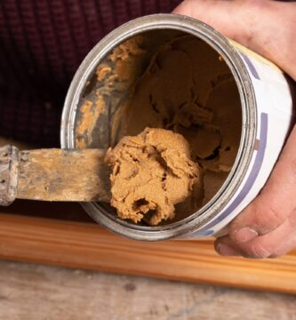 putty and trowel for restoration of wooden furniture and surfaces.